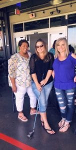 Erika Leiker, center, with friends at a Top Golf team-building event. Leiker hopes the Elira unit can help her reach her weight-loss goal of 30 pounds.