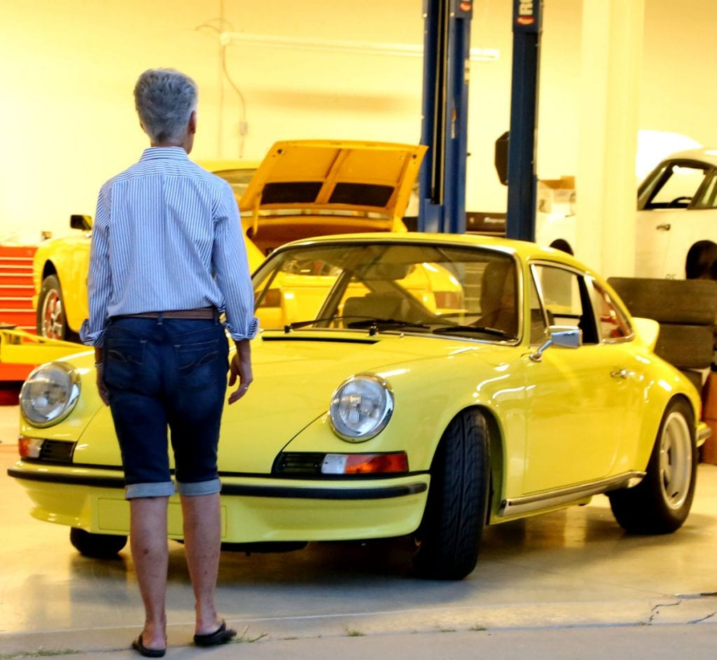 Arnette Schouten with the 1973 Porsche 911 Carrera RS whose proceeds led to the family's donation to the UCHealth University of Colorado Hospital Burn Center. (courtesy April Hagestad)