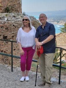 Barb and Bob at a tourist attraction in Italy.