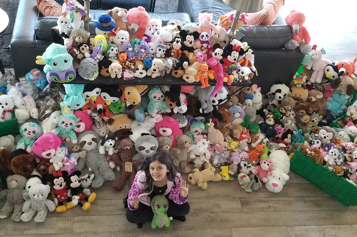 Marlie Walker with all the stuffed animals she collected.