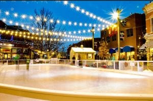 Christmas lights are strung across an empty ice rink in Old Town Fort Collins.