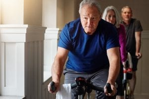 Shot of a group of seniors having a spinning class at the gym