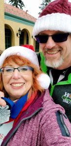 Linda and Keith Chandler pose after a Christmas 5K at Denver's City Park. She shows off her 3rd place medal for her age group.