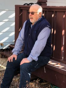 Bob Waddell sits on his deck in his back yard in Colorado Springs.