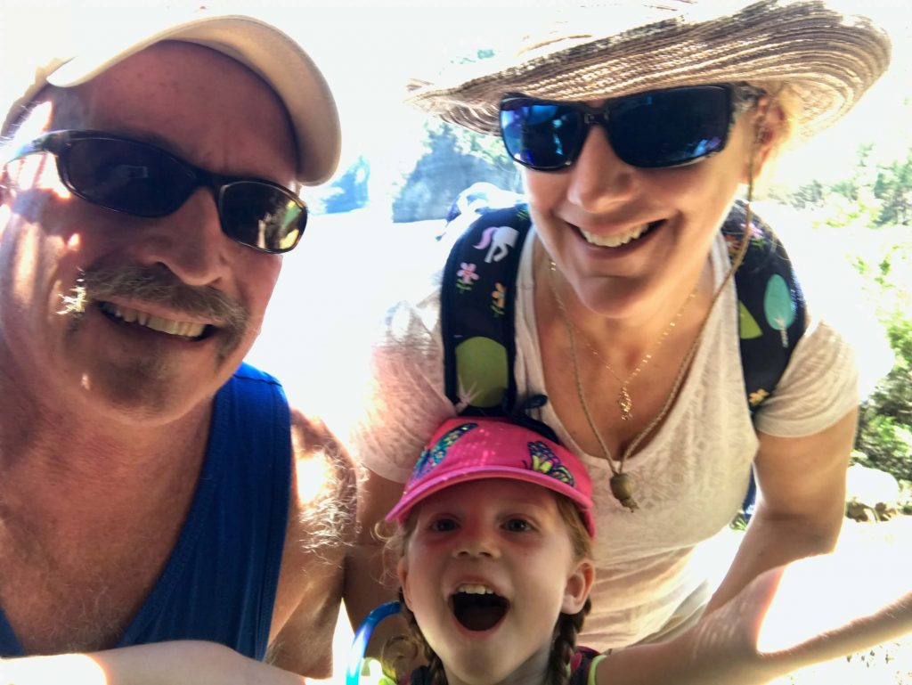 Jeff Schwerdtfeger poses with his wife, Jules, and daughter, Ella, during a hike in Hawaii.