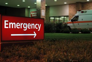 Emergency room entrance at night with ambulance
