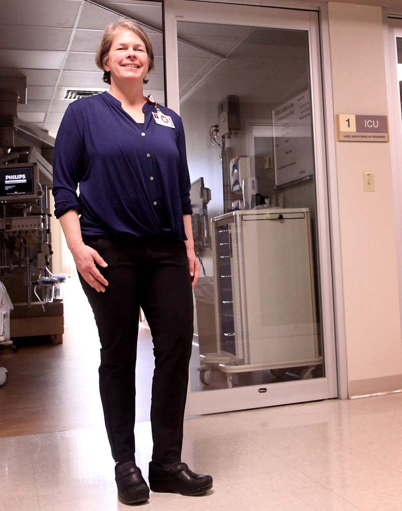 nurse stands in ICU unit