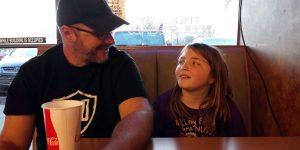 Dan looking at his daughter.