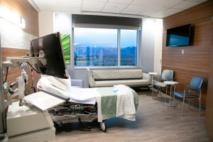 A hospital room with a view toward the mountains in Colorado Springs.