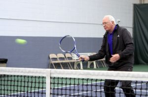 Jim playing tennis.