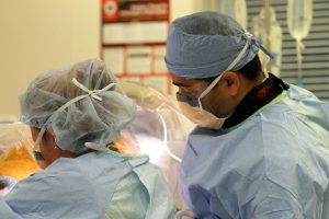 close up of two surgeons in the operating room