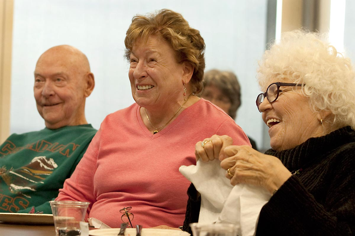 man and two women laughing during a longmont seniors program