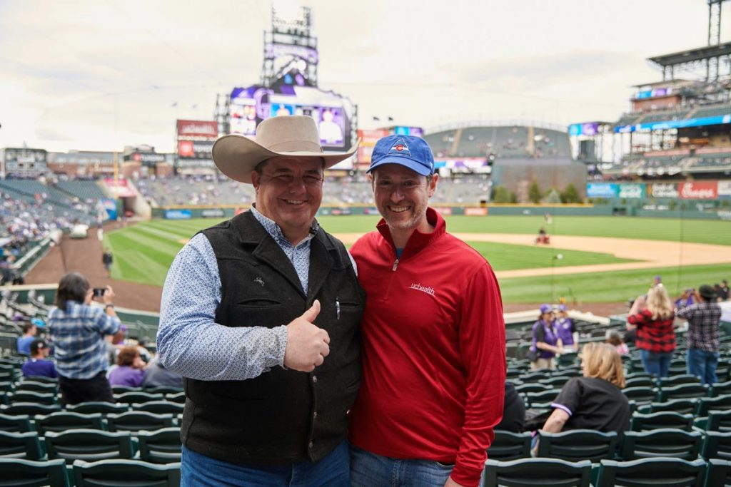 Mike Brashear with Dr. Daniel Pollyea at Coors Field.