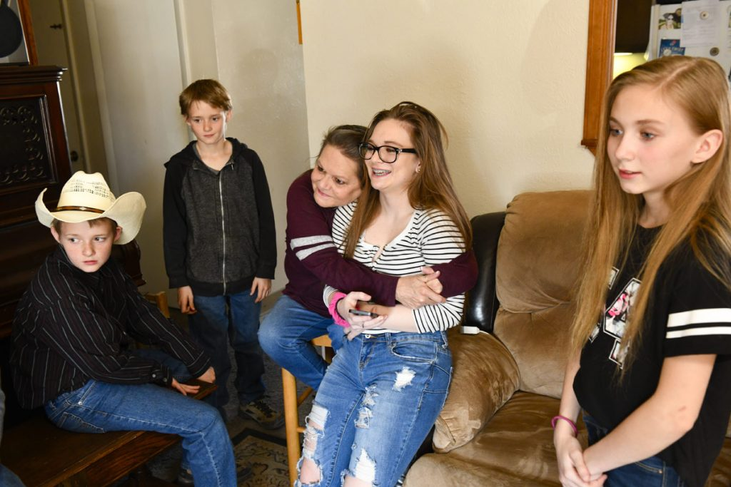 Connie Parke used to be blind, but recently got her vision back. Here she is pictured with multiple grandchildren.