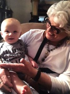 A grandmother holding her grandbaby.