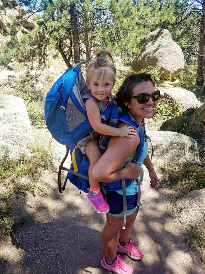 toddler in a backpack on moms back