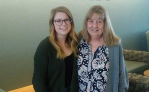 A photo of a mom and daughter together. The mom has survived an abdominal cancer ordeal, while the daughter is in college and interested in a medical career.