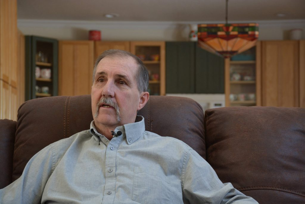 Terry Stauffer in his living room at his Calhan home.