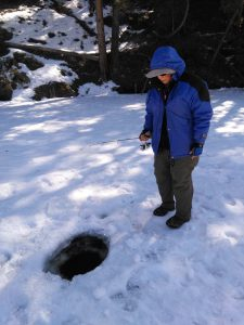 A photo of Lydia Friese ice fishing.
