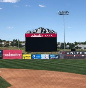 A photo of a scoreboard at UCHealth Park, home of the Rocky Mountain Vibes baseball team.