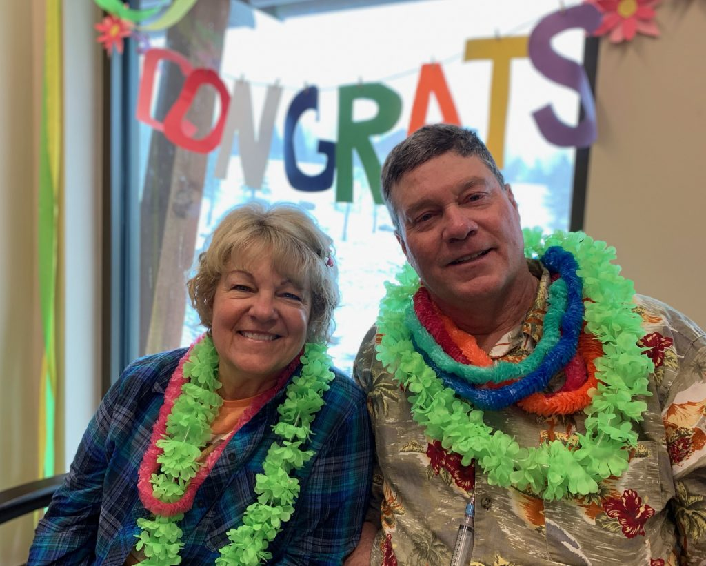 This is a photo of Connie Kassel and Bob Bryant following the surprise Hawaiian day at UCHealth Jan Bishop Cancer Center.