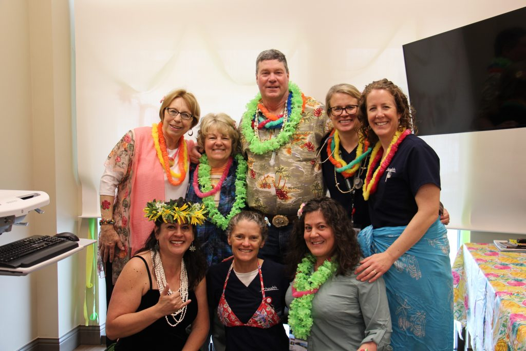 This is a photo of Bob Bryant with his care team at UCHealth Jan Bishop Cancer Center.