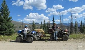 Connie Kassel and Bob Bryant ride four-wheelers in the Zirkel Wilderness in this photo.