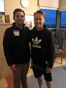 Kyle standing with EMT at hospital