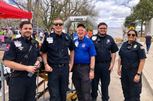 first responders standing at finish line the day of the race