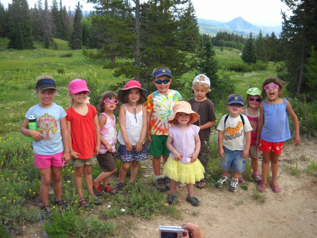 A big group of children camping together.