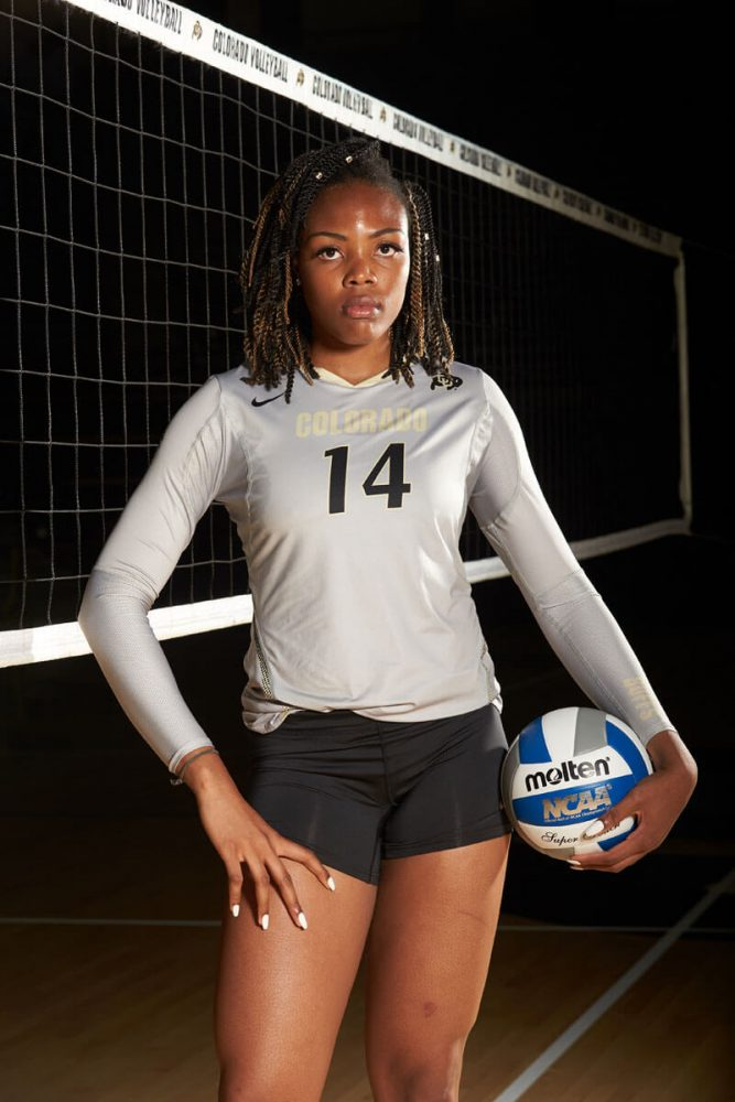 player portrait of her holding ball in front of the net