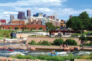 image of confluence park's water features and Denver skyline in the background.