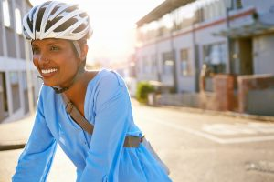 women with bike helmet in the city