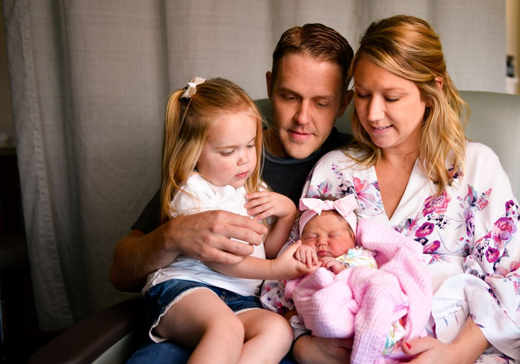 Family photo with older daughter and new baby, the first baby born in Highlands Ranch, CO