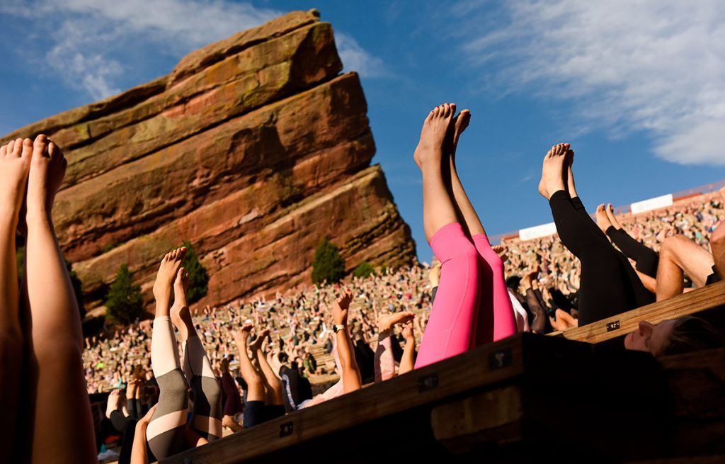 feet in the air during a yoga class at Red Rocks Amphitheater