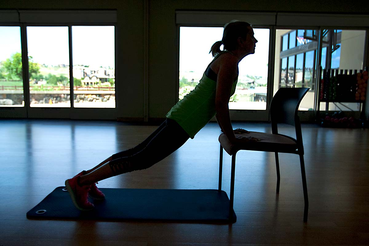 women does yoga pose on chair to help overcome cancer related fatigue