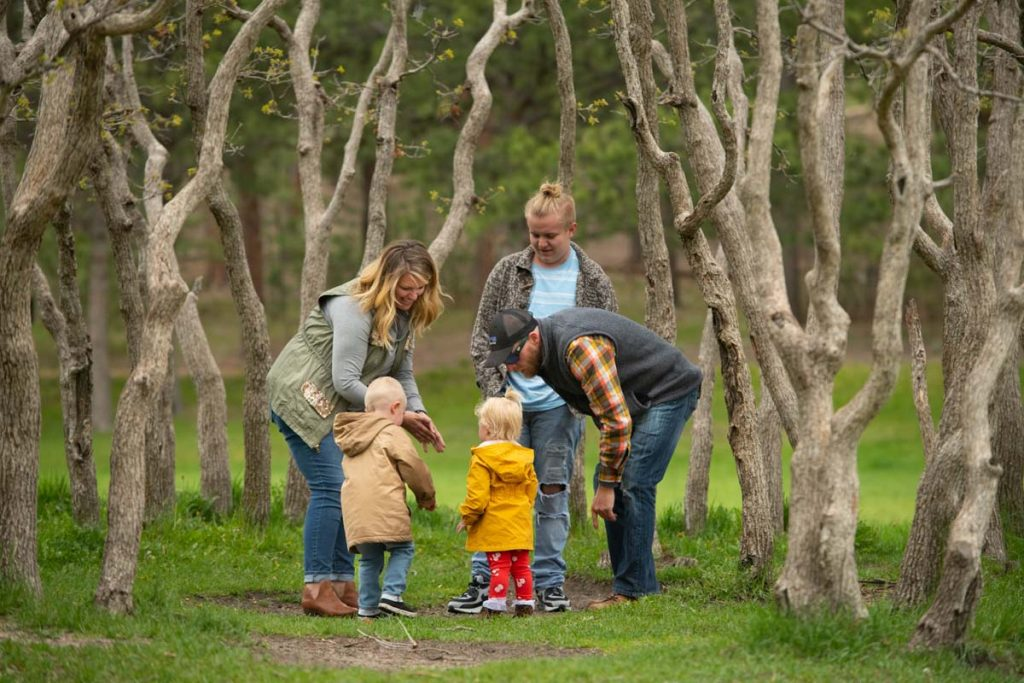 Amber Appleton's family photographed in the trees at Fox Run Regional Park