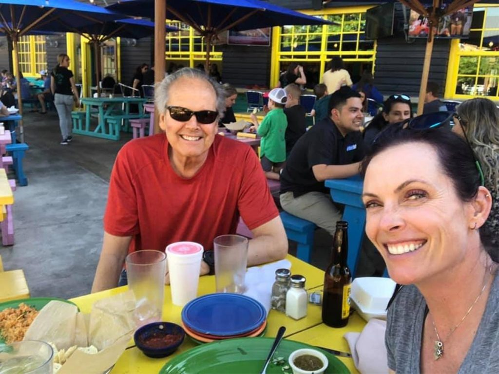 Devereux with daughter Meg in Texas last April. He is enrolled in trial to determine if there is a relationship between prostate cancer and exercise.