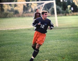 In this photo, Dave Grinnell plays soccer for Hope College in Holland, MI.