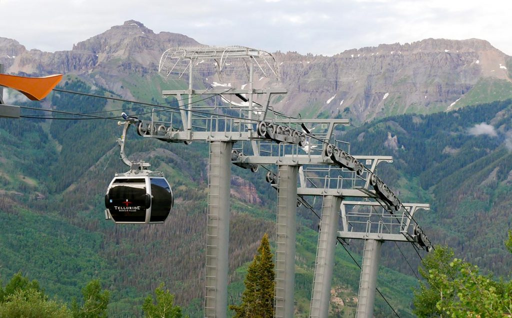 Free gondolas in Colorado include the Telluride gondola here with a view of peaks in the background