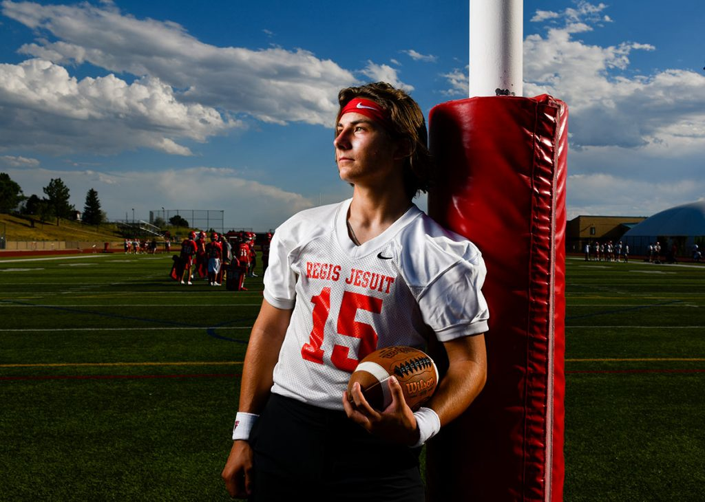 Nicco Marchiol in profile on the football field at Regis Jesuit High School. Marchiol is working with sports performance experts at UCHealth Steadman Hawkins Clinic Denver to run even better.