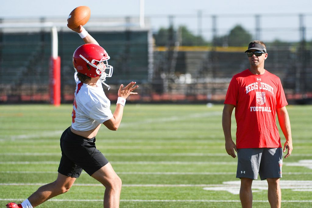 High school quarterback Nicco Marchiol works on his throwing with his Regis coaches. He's been working on sports performance.