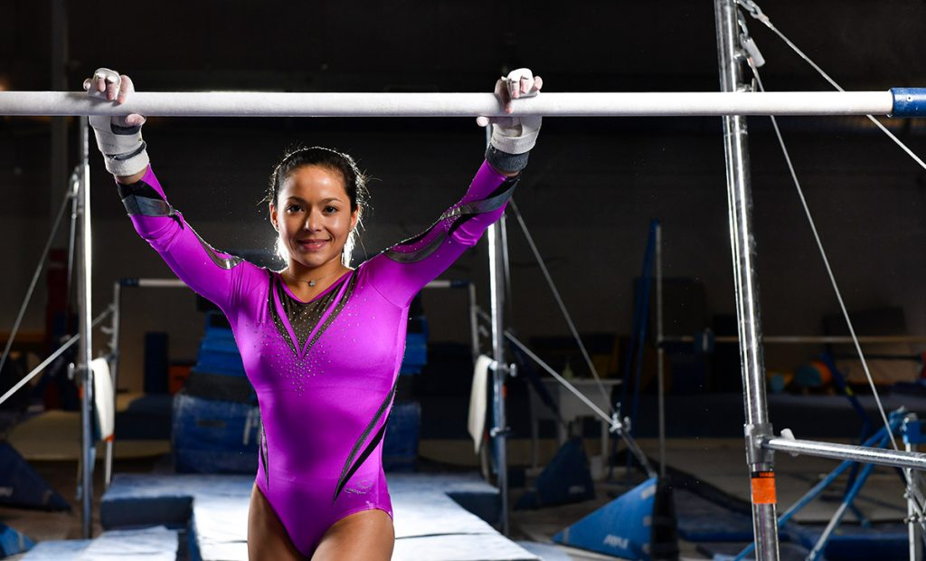Olympic gymnast Jessica Lopez poses with the uneven bars