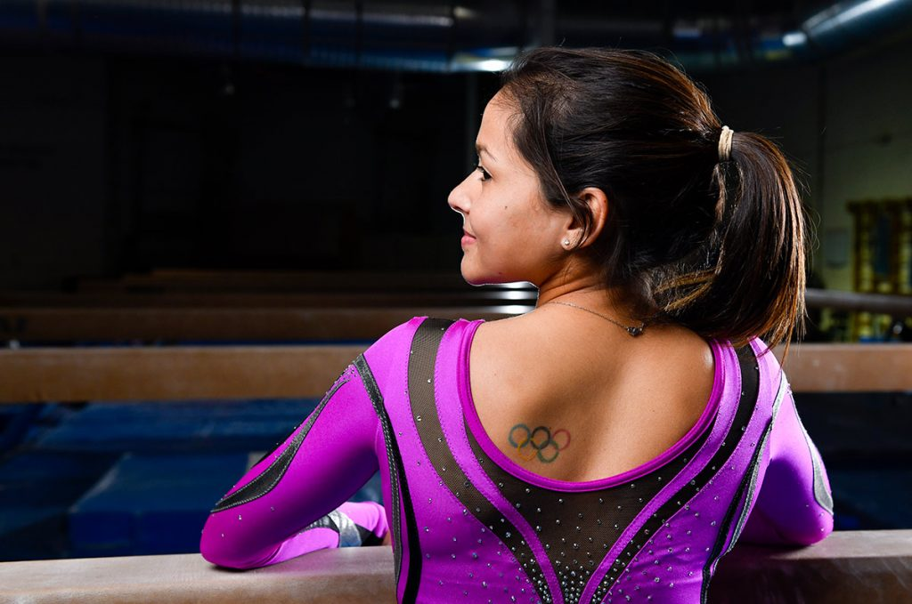 Olympic gymnast Jessica López shows off her tattoo with the Olympic rings.