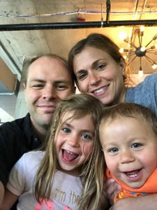 Emily Daniels, who is living with lung cancer, enjoys a happy moment with her husband and their children.