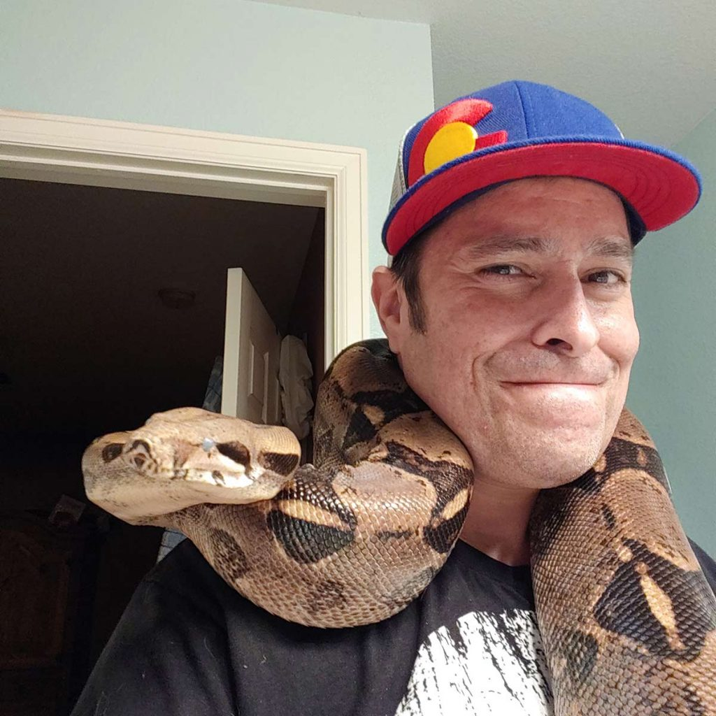 A boa constrictor (he has two) offers Miguel solace as he battles cancer. Photo courtesy of Miguel Birge.