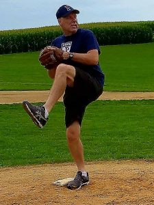 "Just a year ago, Hnida was hurling a baseball with ""Field of Dreams"" cornfields in the background. Photo courtesy of Dave Hnida"