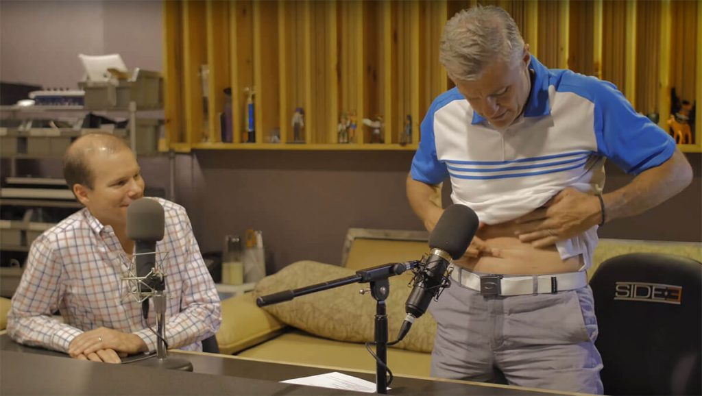 Vic Lombardi points out his scars during a podcast with UCHealth and CU School of Medicine urologic oncologist Dr. Paul Maroni, whose robotic surgery led to those scars.