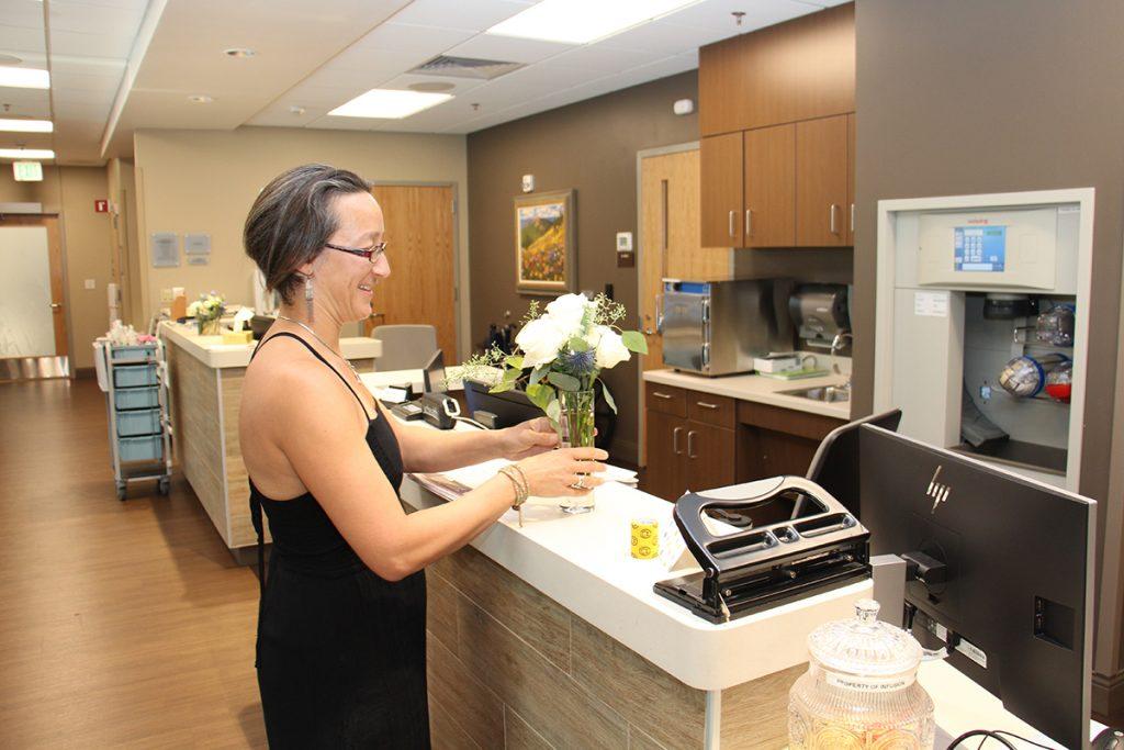 Alex Mathisen delivers flowers to UCHealth Jan Bishop Cancer Center.