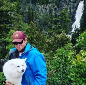 George Gess and dog Kodak hike at Fish Creek Falls in Steamboat Springs.